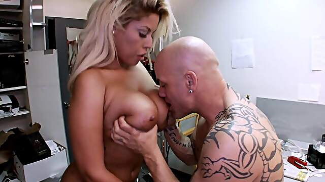 Tattooed Bridgette B moans while her pussy is being licked